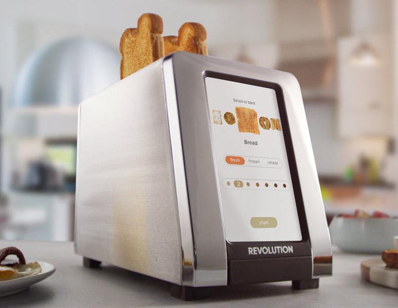 Un grille-pain qui semble faire trois fois la grosseur d'un grille-pain normal, avec un écran tactile à l'avant, où tu sembles pouvoir programmer la couleur de ta toast avec une précision scientifique.